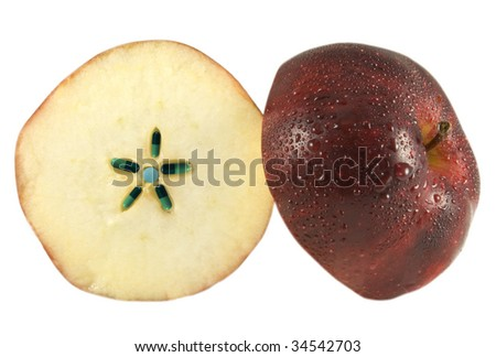 Apple sliced to reveal capsules and pills within - stock photo