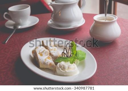 Apple strudel and ice cream  - stock photo