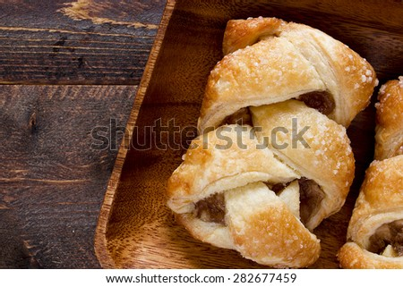 Apple strudel on a wooden plate. Culinary pastries. - stock photo