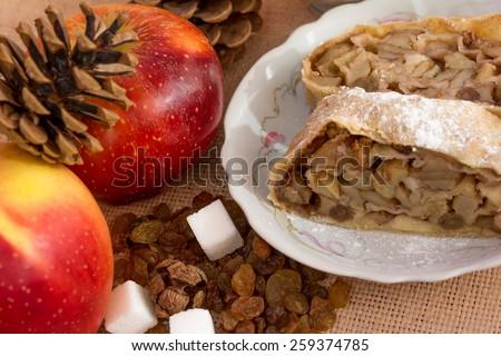 Apple strudel pie dessert with tea closeup  - stock photo