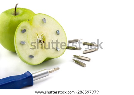 Apple stuck with nails, detail of a fruit with iron, tool abstract, healthy food, fruit