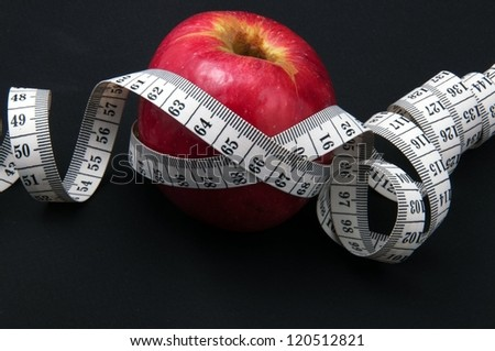 apple surrounded by measurement - stock photo