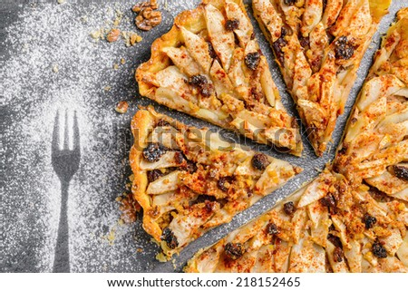 apple tart pie with nuts and raisins - stock photo