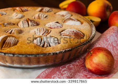Apple tasty traditional homemade delicious breakfast baking pie tart sweet dessert and apples on dark wooden background, selective focus, close up. Pastry. Dessert. Apple Pie. Apple Tart. Pie. Tart   - stock photo