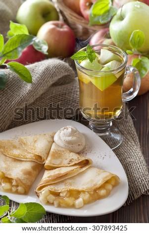 apple tea and pancake stuff with apples - stock photo