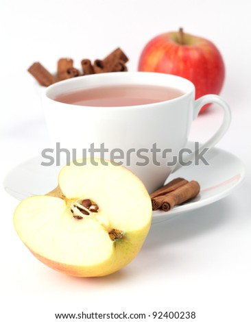 Apple tea with cinnamon on white background. Shallow dof - stock photo