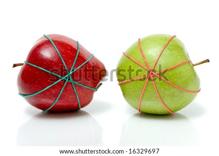apple tied in rubber bands over a white background - stock photo