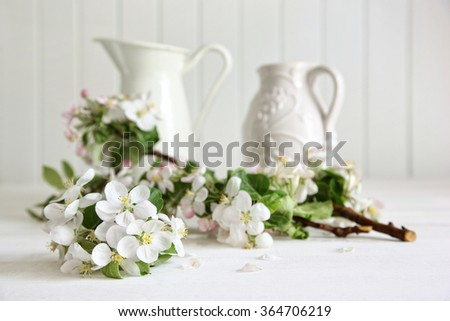 Apple tree branches in a vase on table - stock photo