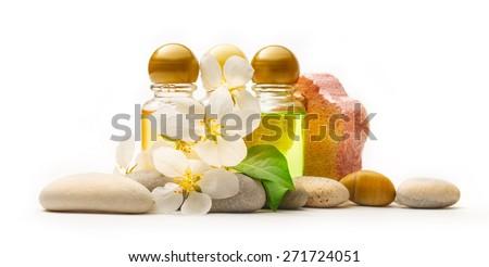 Apple tree flowers, sea stones and shampoo - stock photo