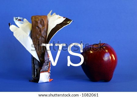 Apple VS candy bar - stock photo