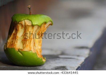 Apple with a bite mark - stock photo
