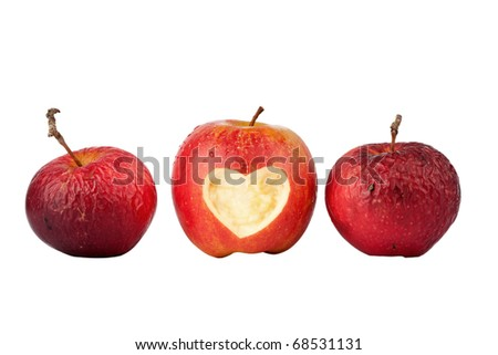 Apple with a heart symbol and two old apples isolated on white - stock photo