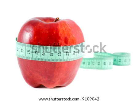 Apple with a measuring tape. Isolation on white