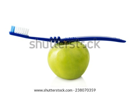 apple with a toothbrush, isolated on white. healthy dental care concepts - stock photo