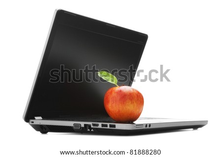 Apple with green leaf on a laptop - stock photo