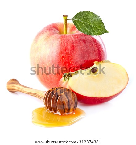 Apple with honey - stock photo