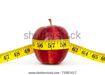 apple with measure tape on white background