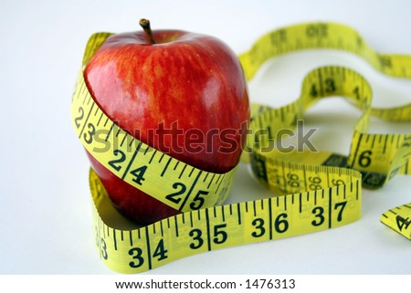 Apple with measuring tape around in white background - stock photo