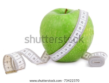 Apple with measuring tape isolated on white