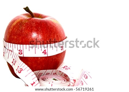 Apple With Measuring Tape Wrapped Around It. - stock photo