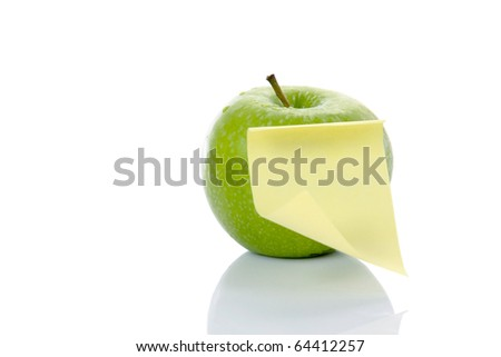 apple with note paper isolated on white backgrond