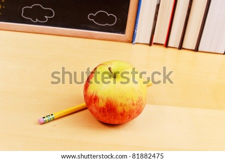 Apple with Pencil - stock photo
