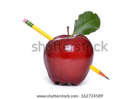 apple with pencil in it white background concept education