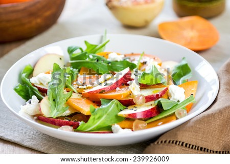 Apple with Persimmon, Rocket ,Pomegranate and Feta salad - stock photo