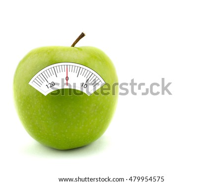 Apple with scales weight, isolated on white background. healthcare concept