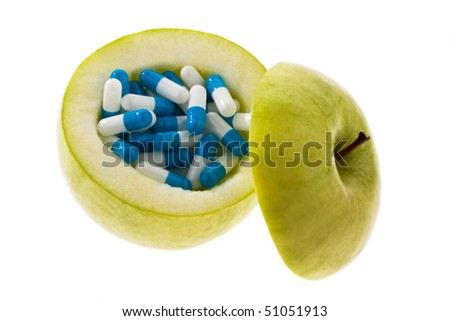 Apple with tablets capsules. Representative photo for vitamin tablets - stock photo