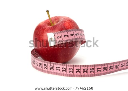 Apple with tape measure isolated on white background. Healthy lifestyle concept.