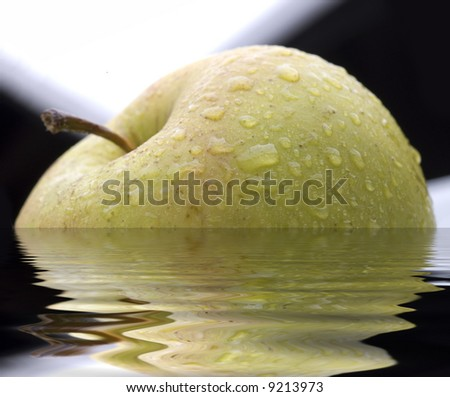 apple with water drops with reflection