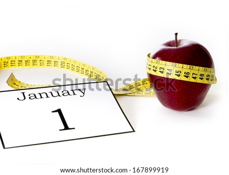 Apple wrapped in tailor tape in concept of Diet and Health - stock photo