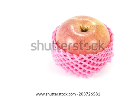 Apple wrapped with foam fruit net isolated on white background. - stock photo
