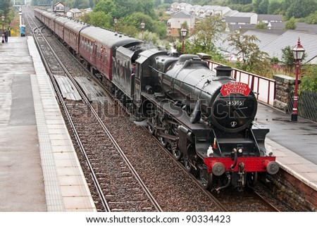 APPLEBY, ENGLAND - AUGUST 6: Preserved steam locomotive 45305 heads the Cumbrian Mountain Express into Appleby station on August 6, 2011, on the Settle to Carlisle railway. - stock photo