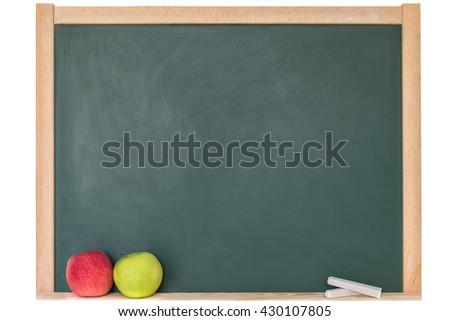 Apples against a blackboard - stock photo