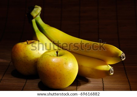 Apples and bananas artistic food still life - stock photo