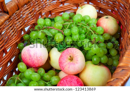 apples and grapes in a basket
