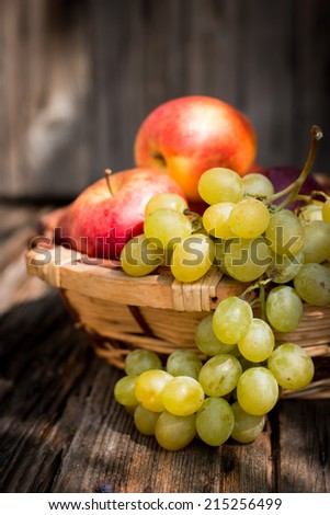 Apples and grapes in a wicker basket
