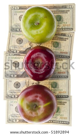 Apples and Money for the Rising Cost of Health Care and Education.  Isolated on White. - stock photo
