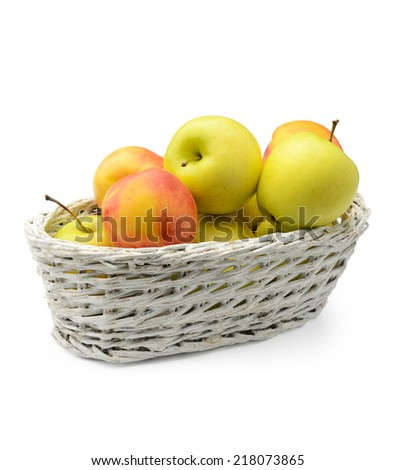 Apples and nectarines in a basket isolated on white background - stock photo