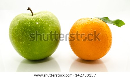 Apples and oranges fresh from the garden isolated white background. - stock photo