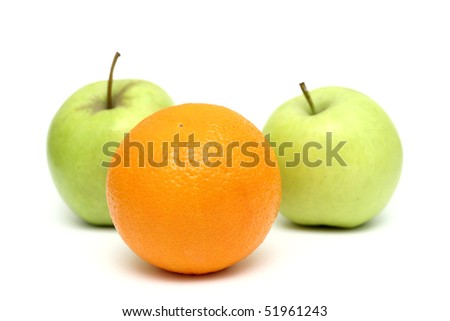 apples and oranges mixed, orange standing out from the crowd - stock photo