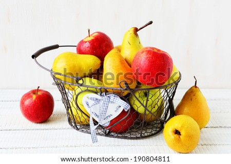 apples and pears in a basket, food closeup
