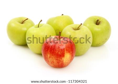 apples arranged on a white background to symbolize teamwork, leadership, discrimination............ - stock photo