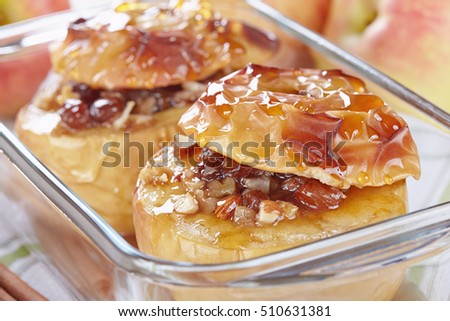 Apples baked with honey, nuts and raisins