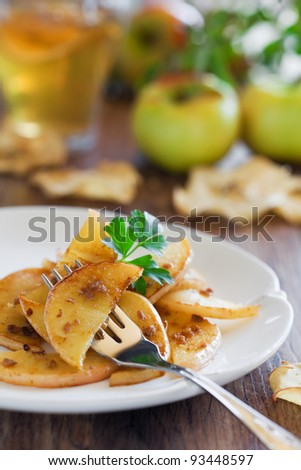 Apples fried with anchovies, selective focus