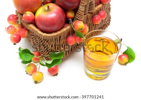 apples in a basket and a glass of apple juice on a white background. horizontal photo. - stock photo