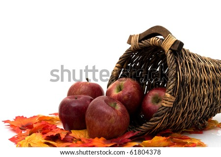 Apples in a Cornucopia isolated on white, Autumn scene