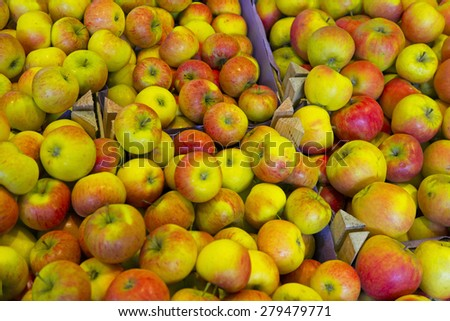 Apples in a wooden box on a market - stock photo